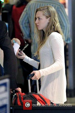 Amanda Seyfried - Celebrities arrive at LAX Airport Los Angeles California United States Monday 21st January 2013