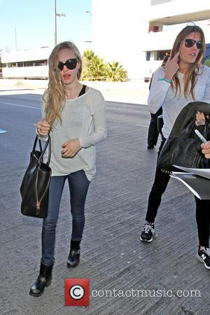 Amanda Seyfried and Jennifer Carpenter - Celebrities arrive at LAX Airport Los Angeles California United States Monday 21st January 2013