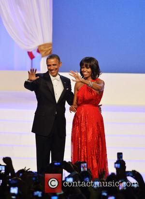 President Barack Obama - President Barack Obama and first lady Michelle...