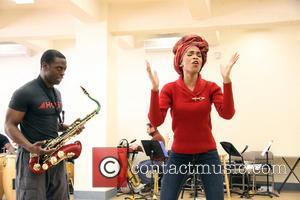 Michelle Williams and Adesola Osakalumi
