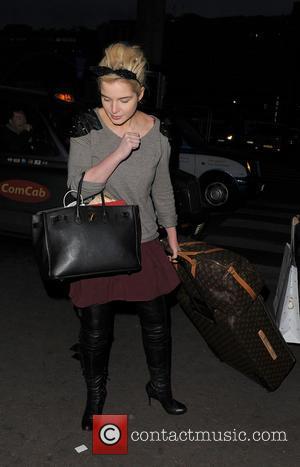 Helen Flanagan - Helen Flanagan arrives at a train station London United Kingdom Thursday 24th January 2013