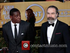 David Harewood and Mandy Patinkin - 19th Annual Screen Actors Guild (SAG) Awards - Arrivals Los Angeles California United States...