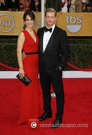 Paul Sparks and Annie Parisse - 19th Annual Screen Actors Guild (SAG) Awards - Arrivals Los Angeles California USA Sunday...