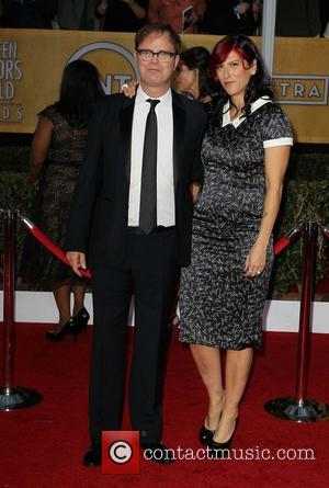 Rainn Wilson and Holiday Reinhorn - 19th Annual Screen Actors Guild (SAG) Awards - Arrivals Los Angeles California USA Sunday...