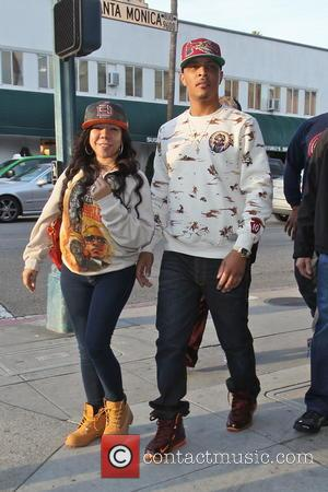 T.I. and Tameka 'Tiny' Cottle - TI In Beverly Hills Los Angeles California USA Monday 28th January 2013