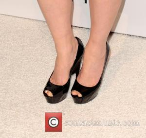 Julia Stiles (shoe detail) - The Hollywood Reporter Nominees Night 2013 Beverly Hills California United States Monday 4th February 2013