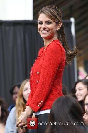 Rocky Carroll and Maria Menounos - Celebrities at The Grove to appear on entertainment news show 'Extra' Los Angeles California...