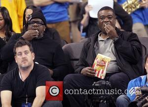 Cedric the Entertainer and Eddie Murray - Celebrities watch as the UCLA Bruins defeated the Washington Huskies Los Angeles Califonria...