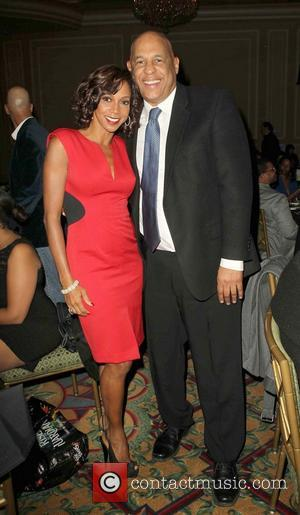 Holly Robinson Peete and Oz Scott