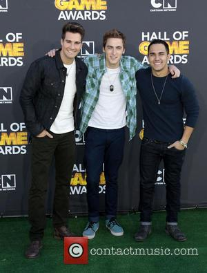 Musicians James Maslow, Kendall Schmidt and and Carlos Pena of Big - Cartoon Network Hall of Game Awards Los Angeles...