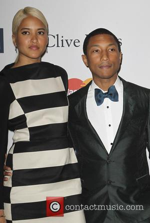 Helen Lasichanh and Pharrell Williams - Clive Davis & The Recording Academy's 2013 Pre-Grammy Gala Los Angeles California United States...