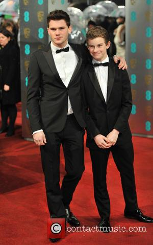Jeremy Irvine and guest - Bafta arrivals London United Kingdom Sunday 10th February 2013