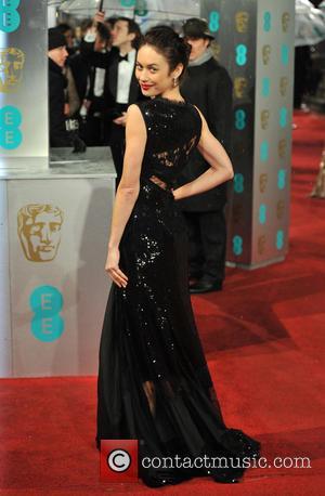 Olga Kurylenko - EE BAFTA arrivals London United Kingdom Sunday 10th February 2013