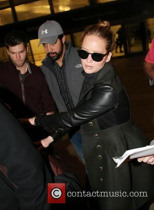 Jennifer Lawrence - Celebrities arriving at LAX airport