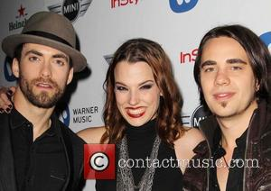 Joe Hottinger, Lzzy Hale and Josh Smith of the band Halestorm - The 55th Annual GRAMMY Awards - Warner Music...