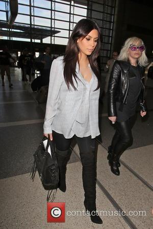 Kim Kardashian - Celebrities arriving at LAX airport