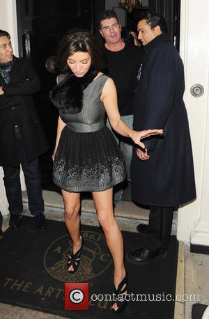 Simon Cowell and Mezhgan Hussainy - The Arts Club celebrities - London, United Kingdom - Saturday 16th February 2013