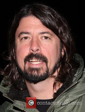 Dave Grohl - Dave Grohl takes his daughters to the Broadway musical 'Annie' at the Palace Theatre at Palace Theatre...