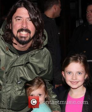 Dave Grohl, Harper Grohl and Violet Grohl - Dave Grohl takes his daughters to the Broadway musical 'Annie' at the...
