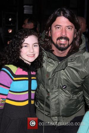 Lilla Crawford and Dave Grohl - Dave Grohl takes his daughters to the Broadway musical 'Annie' at the Palace Theatre...