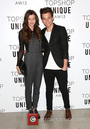 Louis Tomlinson and girlfriend Eleanor Calder - London Fashion Week - Autumn/Winter 2013  - Topshop Unique- Front Row at...