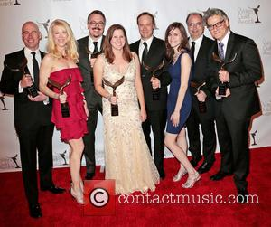 Writers Sam Catlin, Moira Walley-beckett, Vince Gilligan, Gennifer Hutchison, George Mastras, Thomas Schnauz, Peter Gould and Winners Of The Writers Guild Award For Outstanding Drama Series