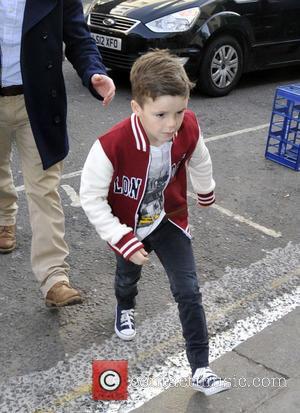 Cruz Beckham - The Beckham family arrive at a London entertainment venue at Heart Radio - London, United Kingdom -...