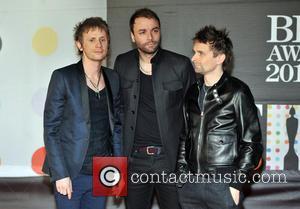 Dominic Howard, Matt Bellamy and Chris Wolstenholme - The 2013 Brit Awards at Brit Awards - London, United Kingdom -...