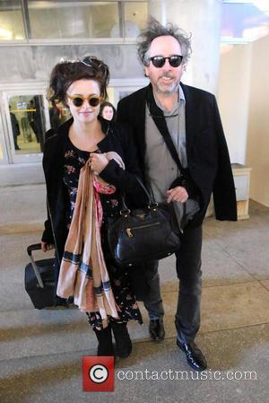 Tim Burton and Helena Bonham Carter - Director Tim Burton and Helena Bonham Carter arrives at LAX airport - Los...