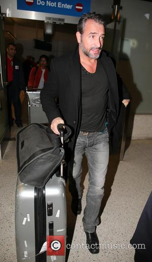 Jean Dujardin - Celebrities arriving at LAX airport - Los Angeles, California, United States - Thursday 21st February 2013