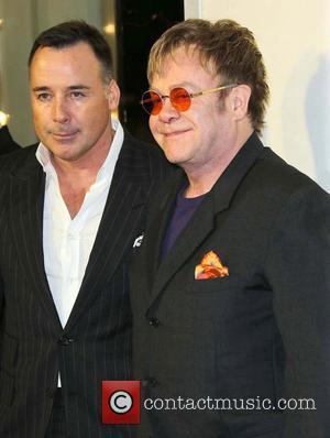 Sir Elton John, David Furnish and Tom Ford