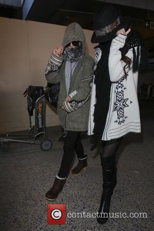 Vanessa Hudgens and Selena Gomez - Stars of the upcoming film 'Spring Breakers' arrive at LAX airport together after a...