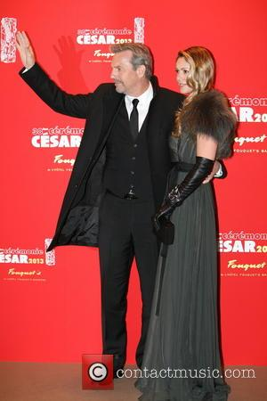 Kevin Costner and Christine Baumgartner - 23/2/2013, Paris. France kevin costner et sa femme arrive au Fouquets apres la ceremonie...