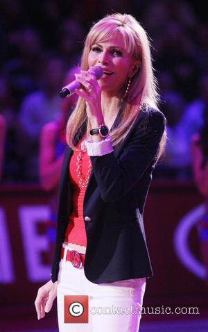 Shawn Southwick - Larry King's wife, Shawn Southwick, sings the national anthem before the Los Angeles Clippers and Utah Jazz...