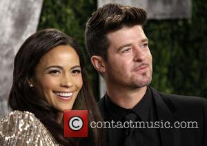 Paula Patton and Robin Thicke - 2013 Vanity Fair Oscar Party at Sunset Tower - Los Angeles, California, United States...