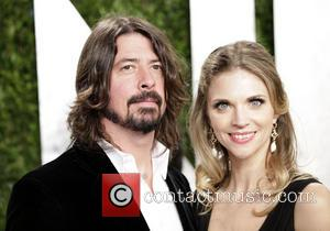 Dave Grohl and Jordyn Blum - 2013 Vanity Fair Oscar Party at Sunset Tower - Arrivals - Los Angeles, California,...