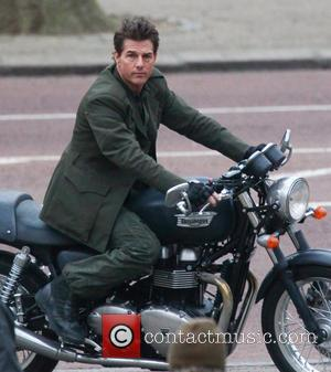 Tom Cruise - Tom Cruise rides on a Triumph motorbike down the Mall while filming a scene from his movie...