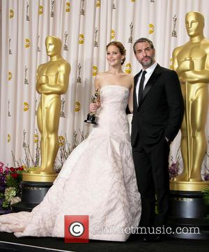 Jennifer Lawrence and Jean Dujardin - Oscars Press Room at Oscars - Los Angeles, California, United States - Sunday 24th...