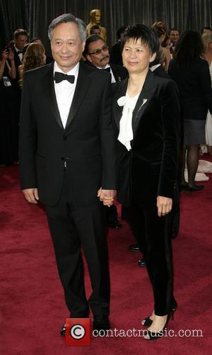 Best Director winner Ang Lee with his wife