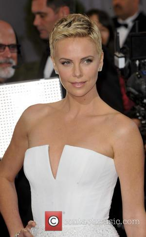 Charlize Theron Helps Guard Who Suffered Oscars Seizure