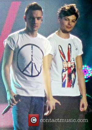 Liam Payne and Louis Tomlinson - One Direction performing during the second night of their Take Me Home World Tour...