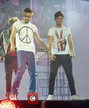 Niall Horan, Liam Payne, Lois Tomlinson and One Direction - One Direction perform at London's O2 Arena - London, United...