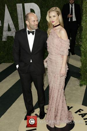 Jason Statham and Rosie Huntington-Whiteley - 2013 Vanity Fair Oscar Party at Sunset Tower - Arrivals - West Hollywood, California,...