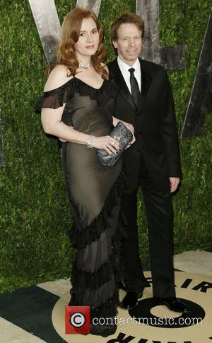 Jerry Bruckheimer and Guest - 2013 Vanity Fair Oscar Party at Sunset Tower - Arrivals - West Hollywood, California, United...