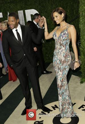 Michael Strahan and Nicole Murphy - 2013 Vanity Fair Oscar Party at Sunset Tower - Arrivals - West Hollywood, California,...