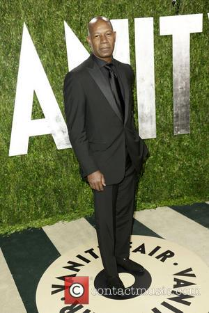 Dennis Haysbert - 2013 Vanity Fair Oscar Party at Sunset Tower - Arrivals - Los Angeles, CA, United States -...