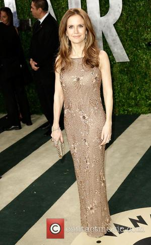 Kelly Preston - 2013 Vanity Fair Oscar Party at Sunset Tower - Arrivals - Los Angeles, California, United States -...
