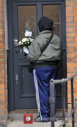 Fearne Cotton and A Courier Delivers Flowers