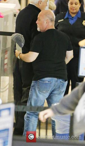Billy Joel - Billy Joel and his wife Alexis Roderick passes through airport security at Los Angeles International LAX airport...