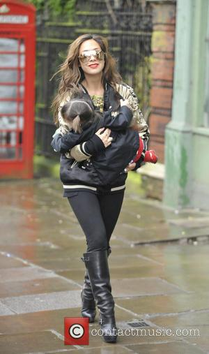 Myleene Klass and Hero Quinn - Myleene Klass walks daughters Ava and Hero to school. Myleene looked very trendy ina...